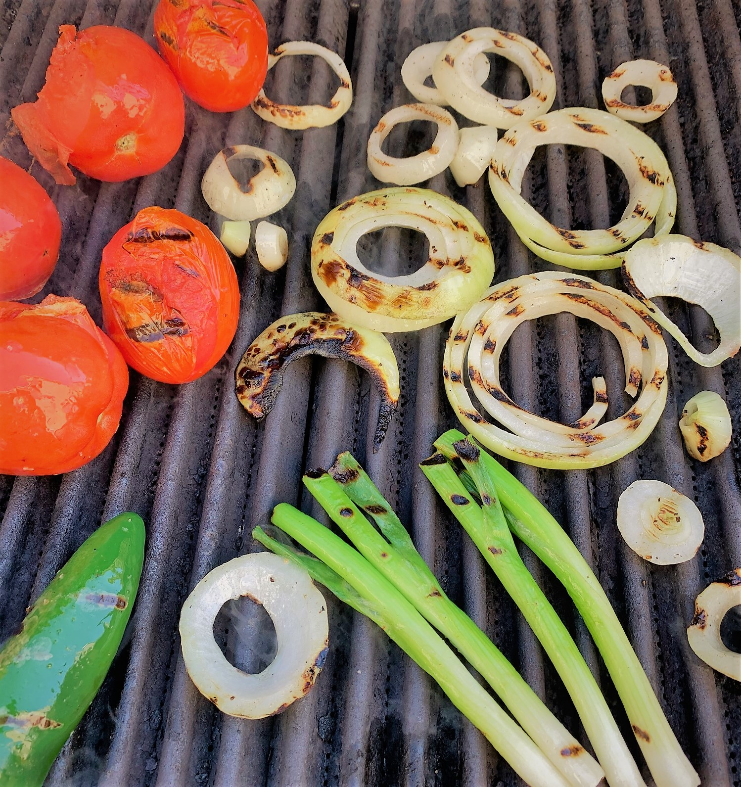 Grilling the vegetables for our Fire Roasted Tomato Salsa
