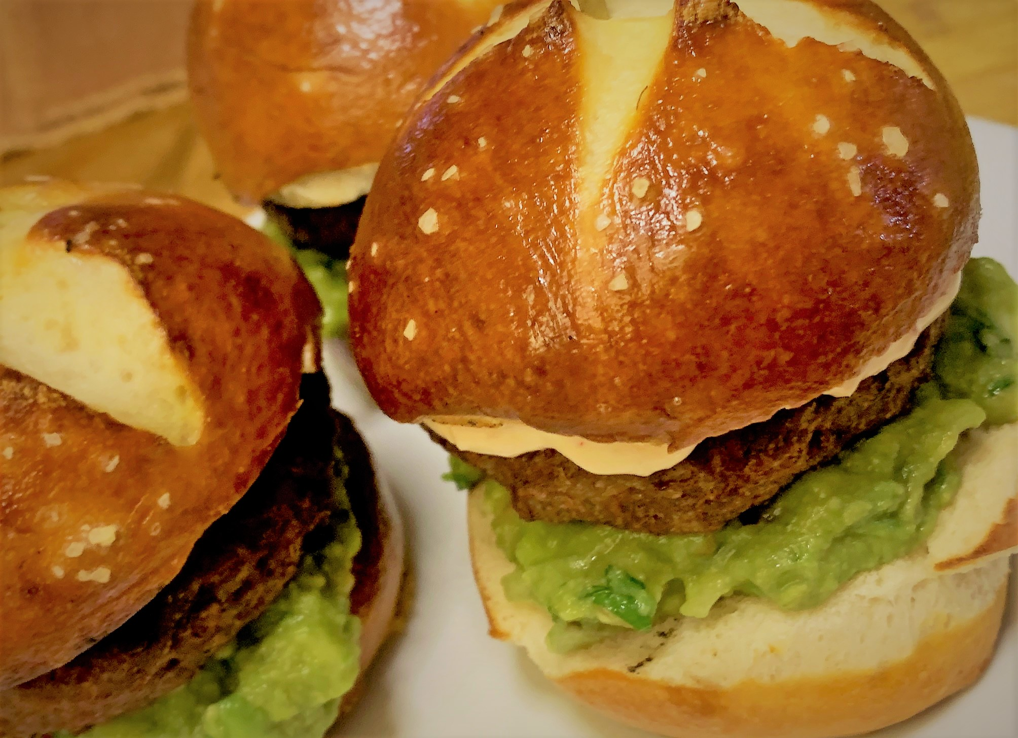 Our Pretzel Slider Rolls used in the Petite Plant Based Burger with Guacamole