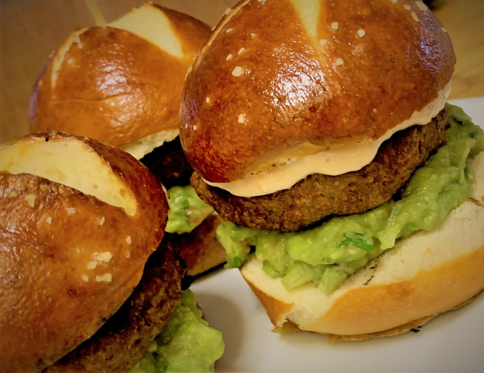 Our assembled Petite Plant-Based Burgers with Guacamole