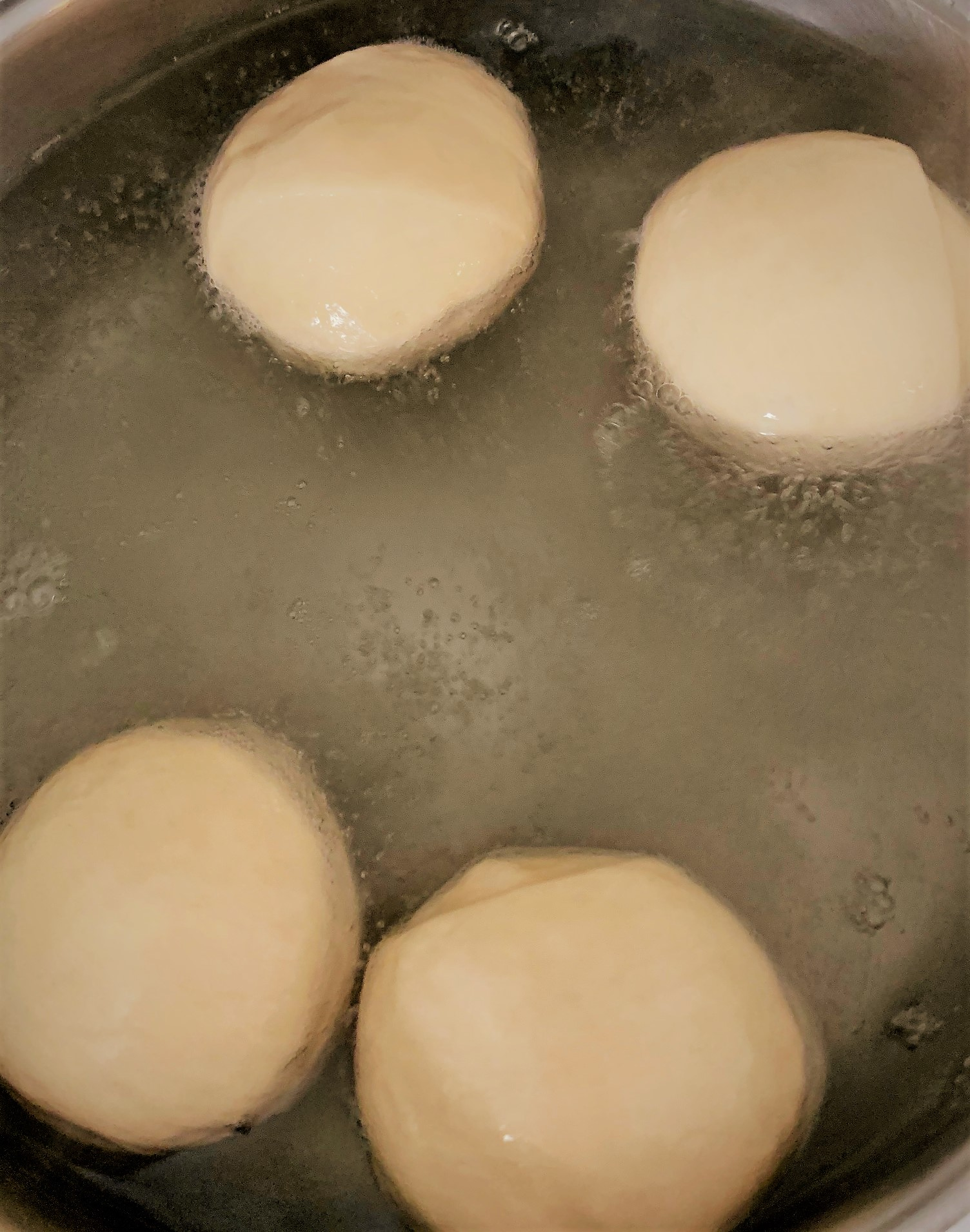 Boiling our Pretzel Slider Rolls before baking