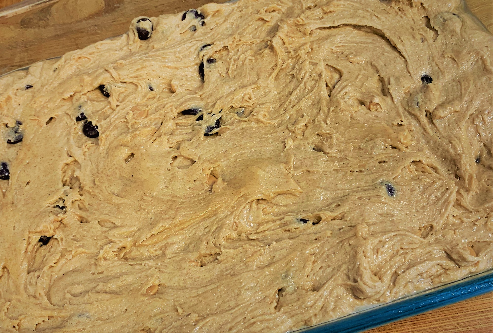 Our Peanut Butter Cup Cake Bar Batter spread within the Baking Dish