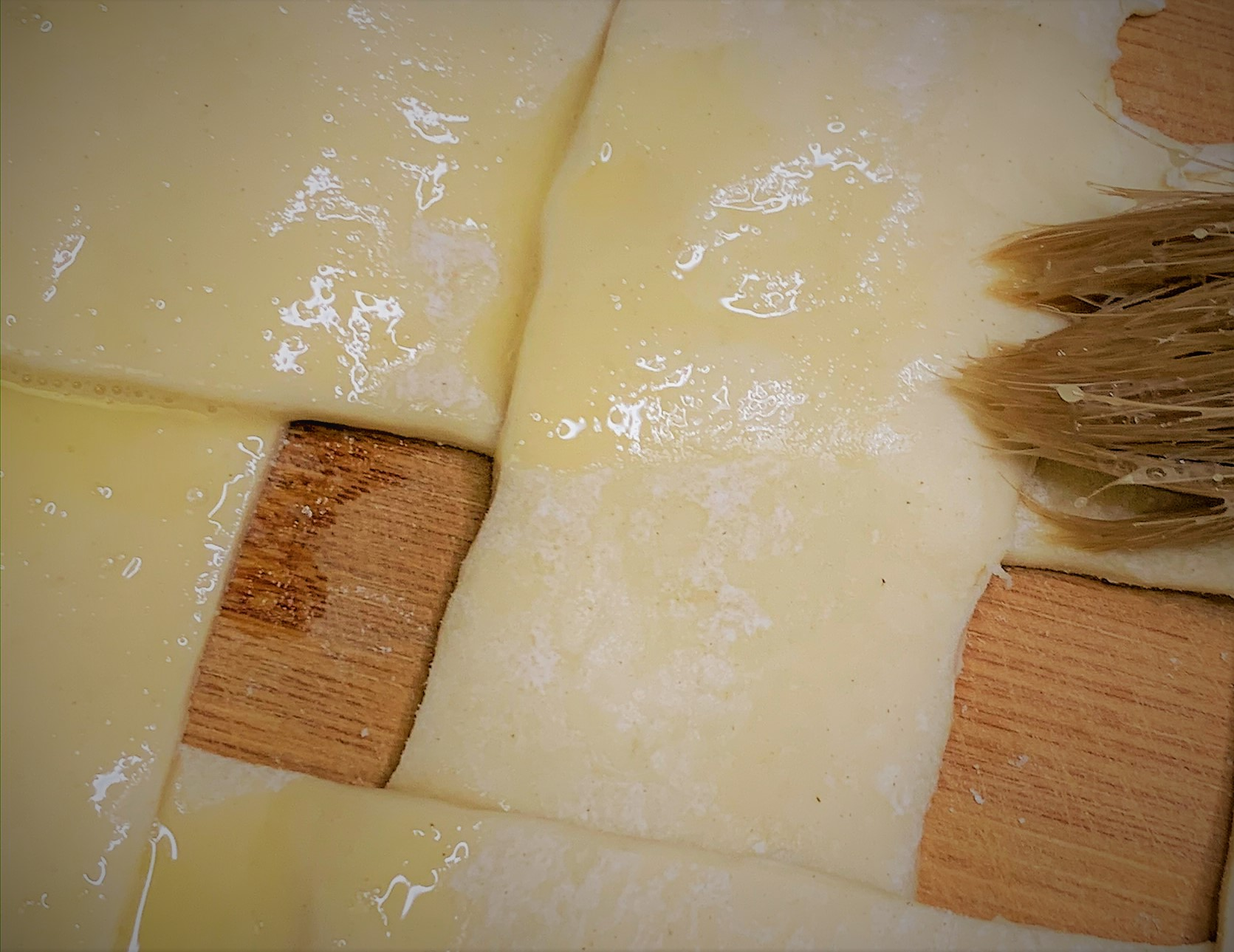 Brushing Egg Wash on the Puff Pastry Topping for our Guinness Braised Short Rib Pot Pie