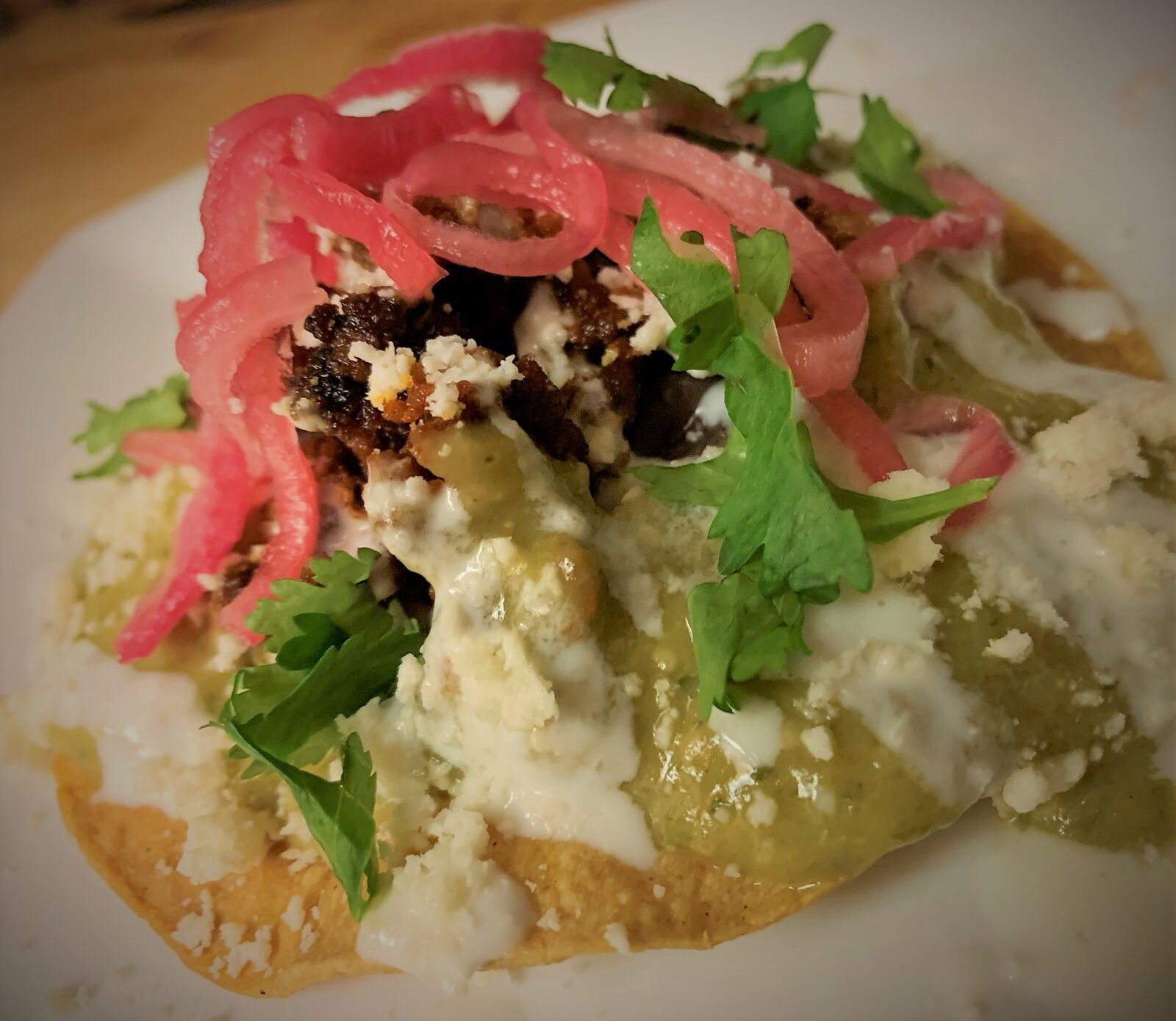 Our plated Tostada de Chorizo from Las Posadas Holiday Kitchen