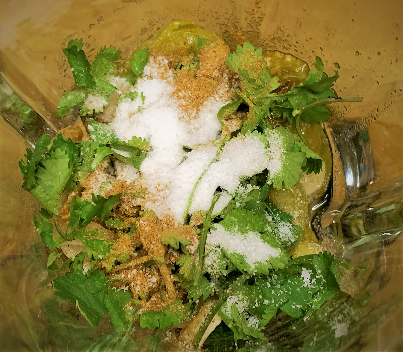 Adding the Cilantro, Cumin and Salt added to our Salsa Verde Ingredients in a blender