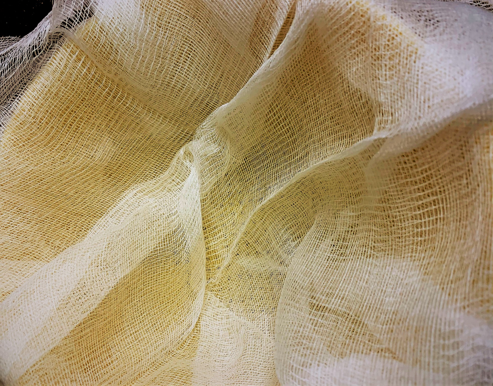 Layers of Cheese Cloth for our shredded Potatoes and Onions