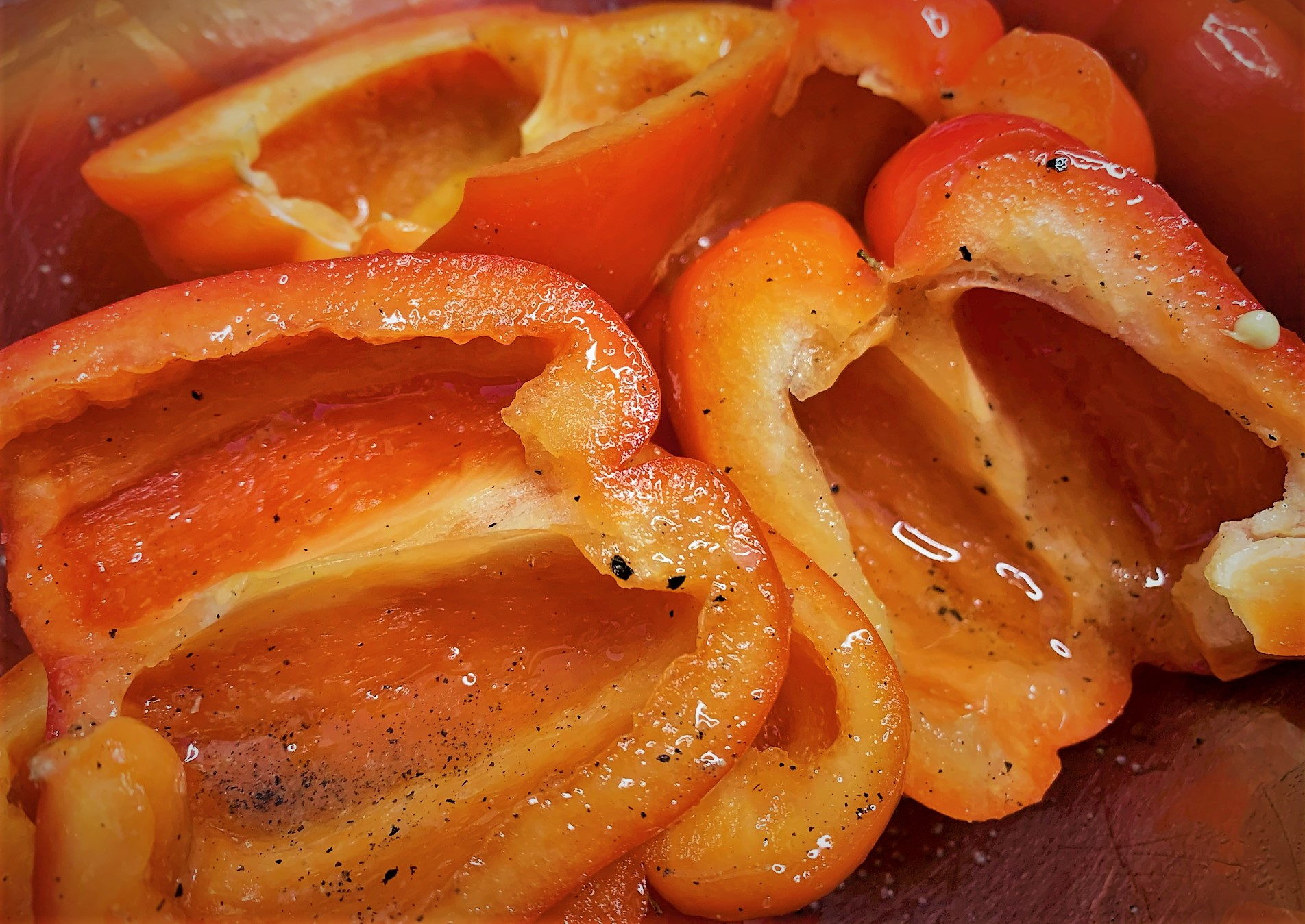 Split Red Bell Peppers with Oil, Salt and Pepper