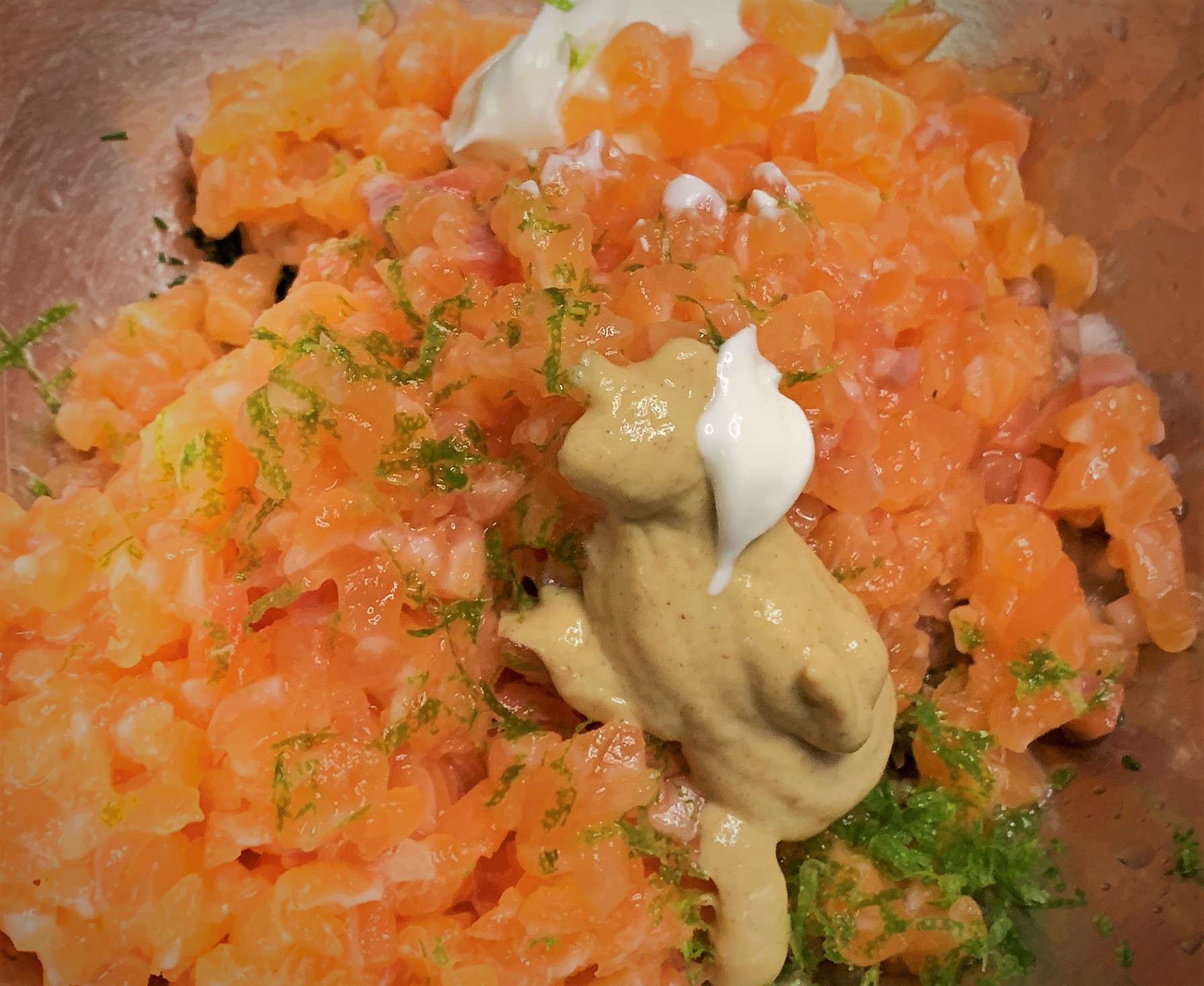 The Salmon Tartare ingredients added to a bowl prior to mixing