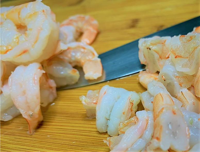 Chopping the cooked Shrimp