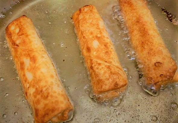Frying the second side of our Pongu Lumpia