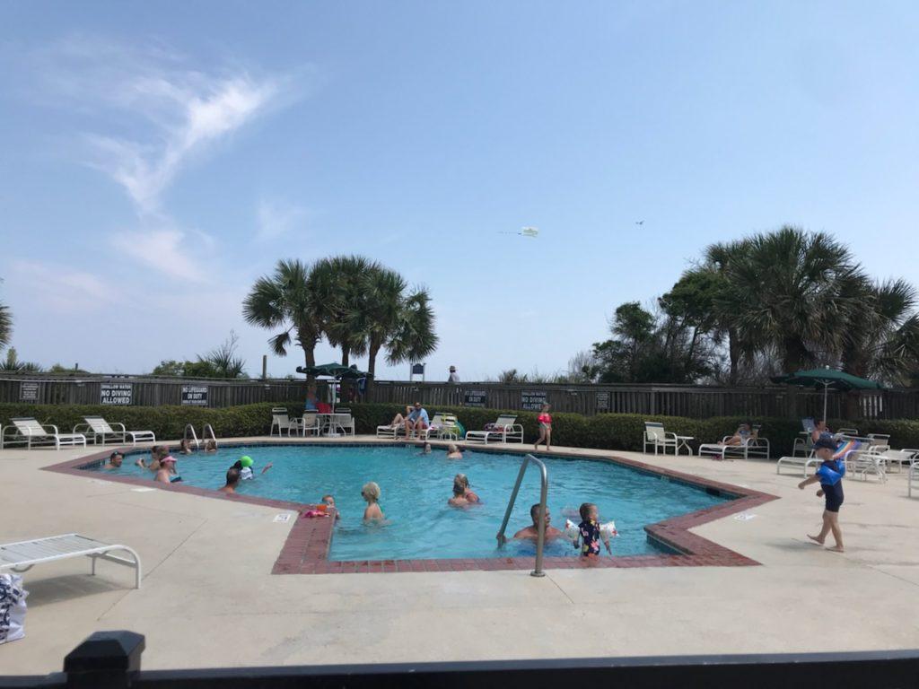 Families Enjoying The Oceanfront South Hampton Pool