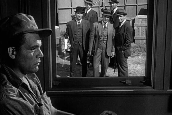 In a composite shot, Capone contemplates his future at Alcatraz after The Untouchables prevent his escape.