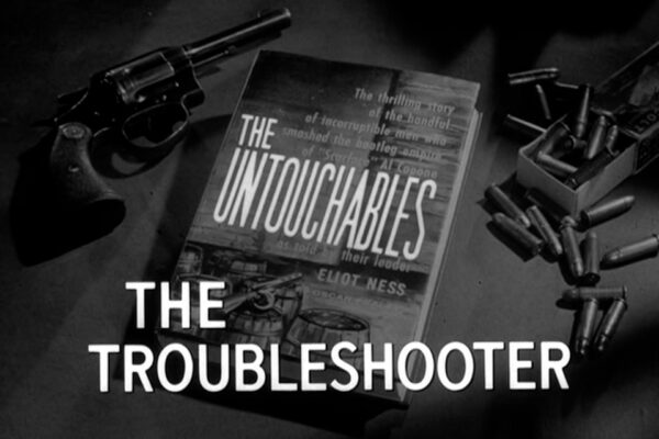 """""""The Troubleshooter"""" originally aired on October 12th, 1961. Suffering from federal raids, the syndicate hires a devious fixer from New York who works to undermine Eliot Ness."""
