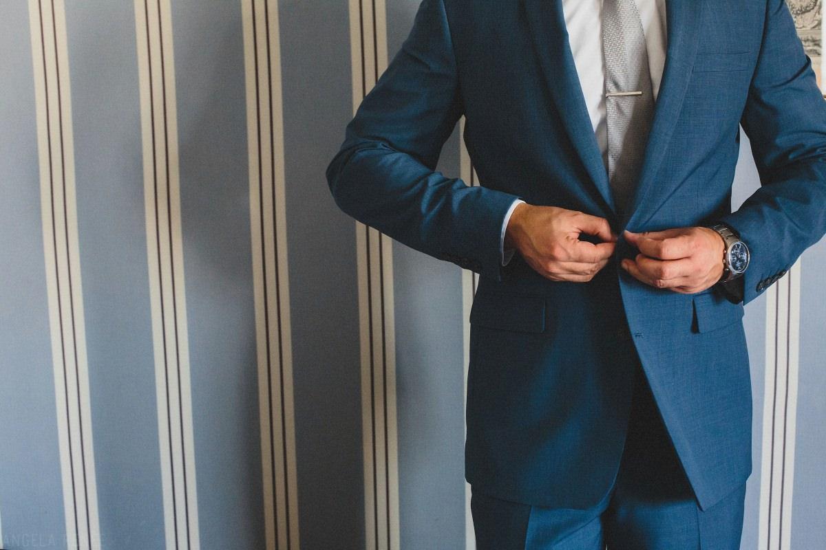 paris-groom-putting-on-suit