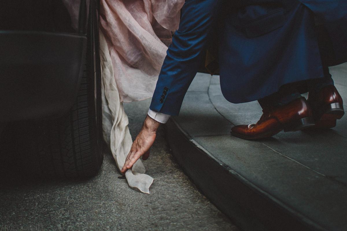 groom-carries-brides-dress