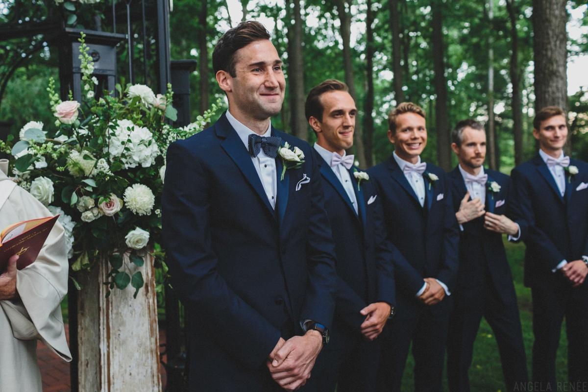 groom-looks-at-bride-down-aisle