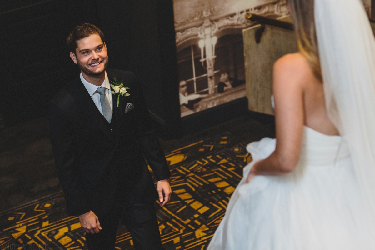 groom seeing bride for first look