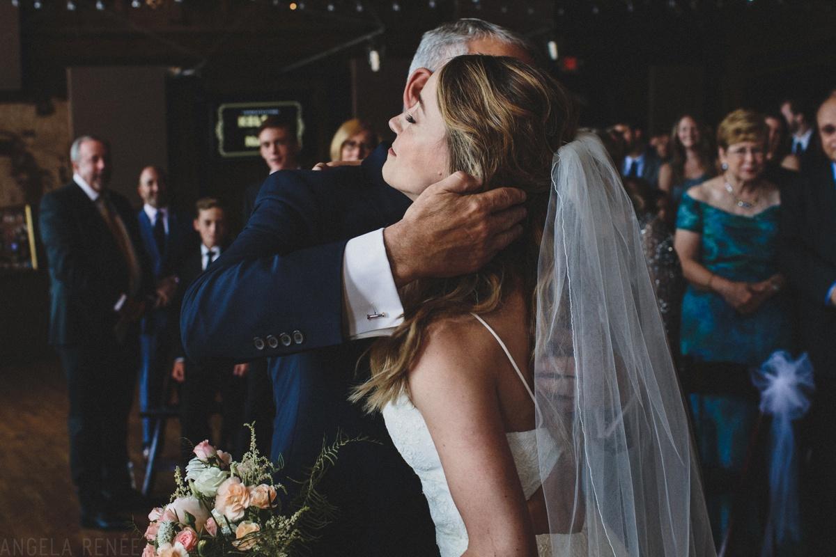 bride hugging father