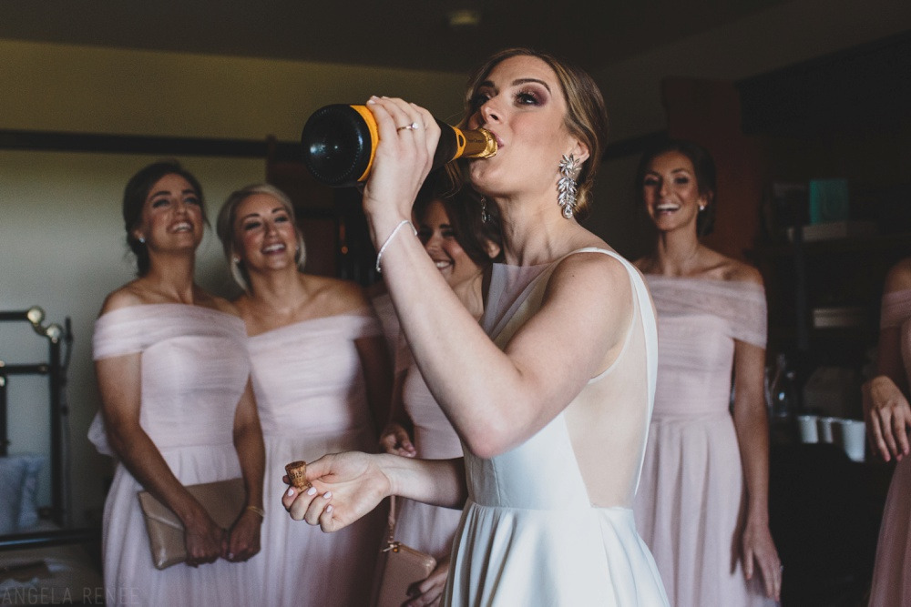 bride-putting-on-dress