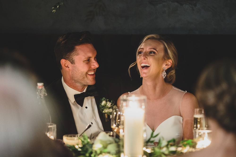 candid-laughing-wedding-couple