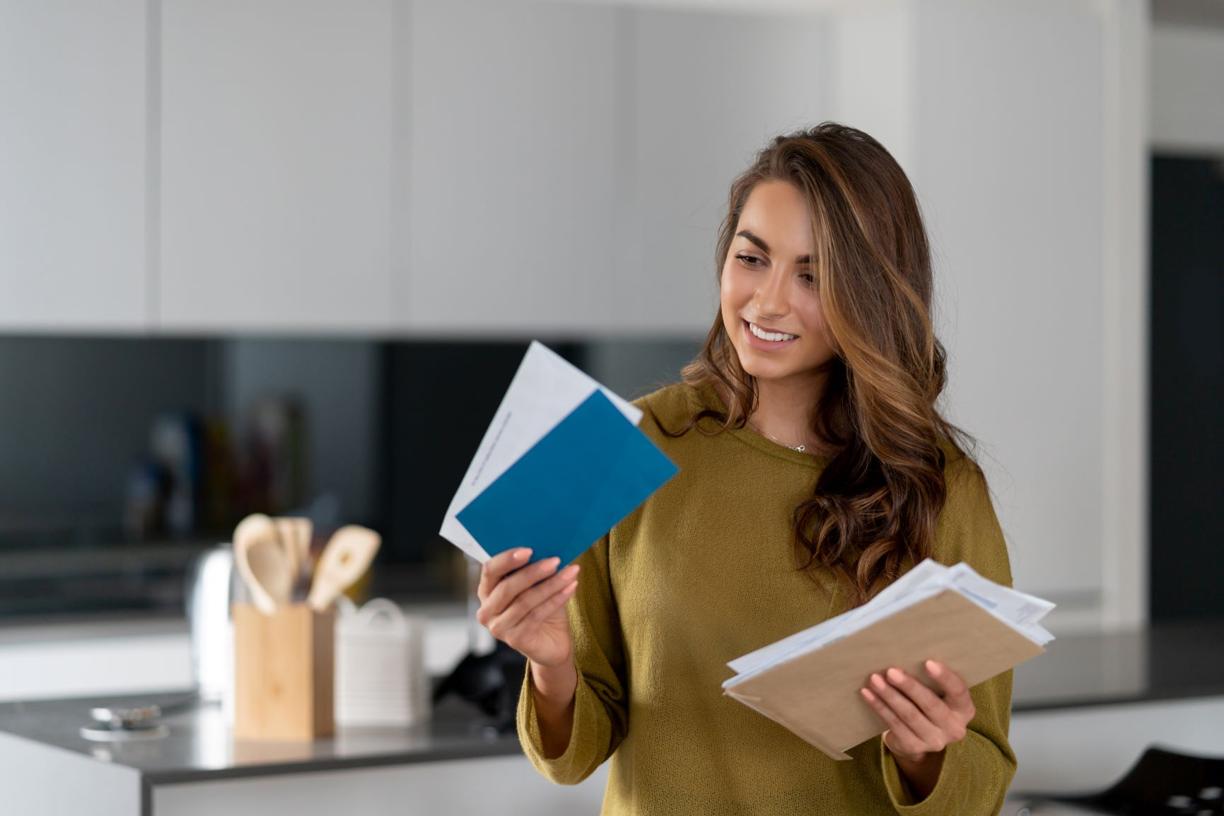 Woman opening mail