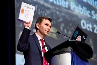 David Sinclair holding a book