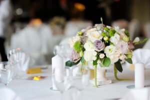 Flowers on table with candles glasses photo