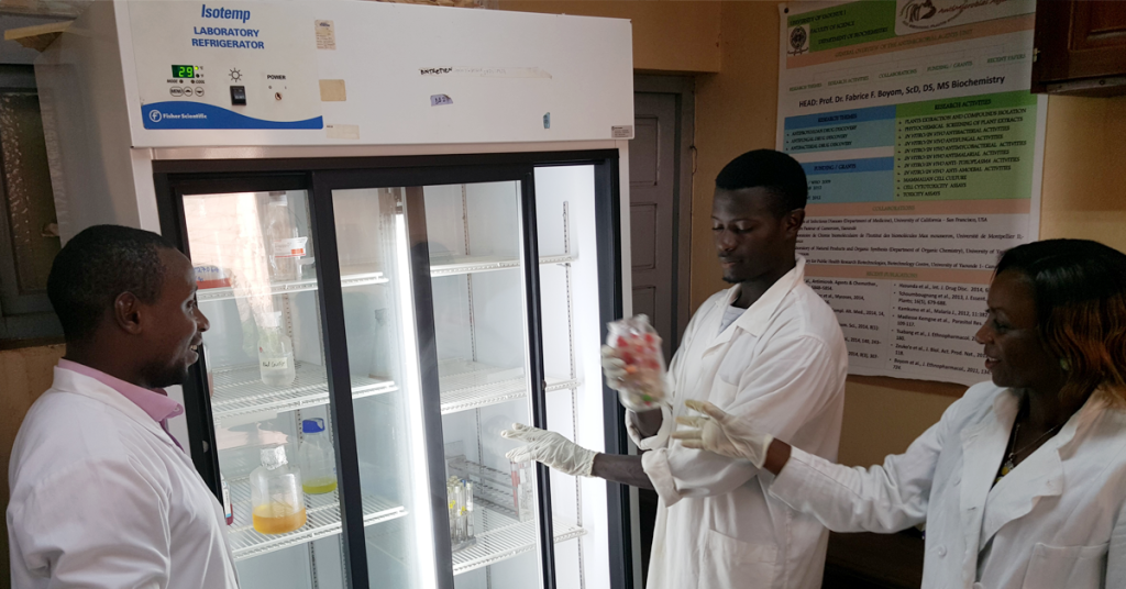 Dr. Boyom's students retrieving samples from a refrigerator from Seeding Labs