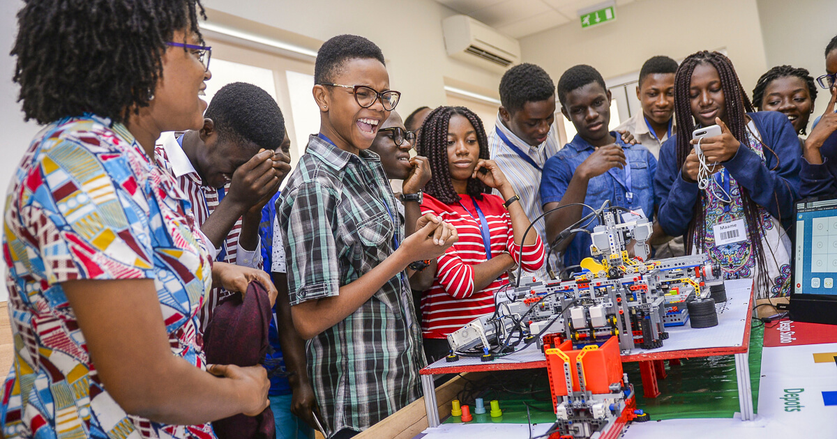 Lecturer engaging with students in Robotics class