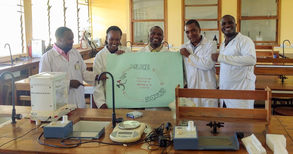 Mr Fednand Kindole, Ms Flaviana Ngabala, Mr Beatus Chaffu, Mr Hazina Charles and Mr Stephano Mlozi holding friendship poster