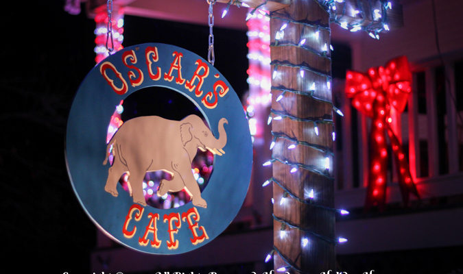 Close Up Shot Of Oscar's Cafe Sign Lights By Handsome Holiday Heroes!