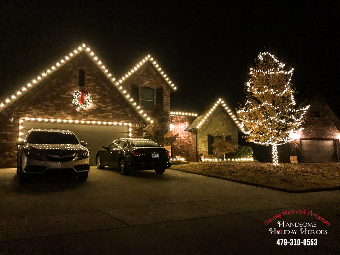 house at night with Christmas lights in Bentonville Arkansas