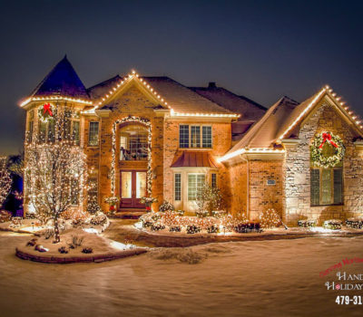 House At Night With Snow And Christmas Lights In Bentonville Arkansas