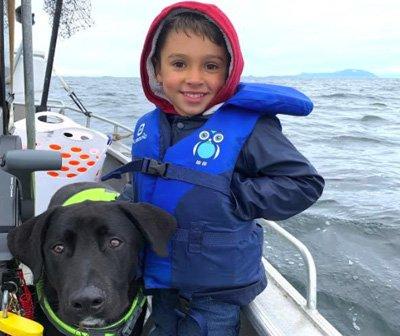 Chris Brigg's son and dog