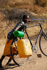 Youth transporting water by bicycle.  (copyright Tobi Bruce 2009)