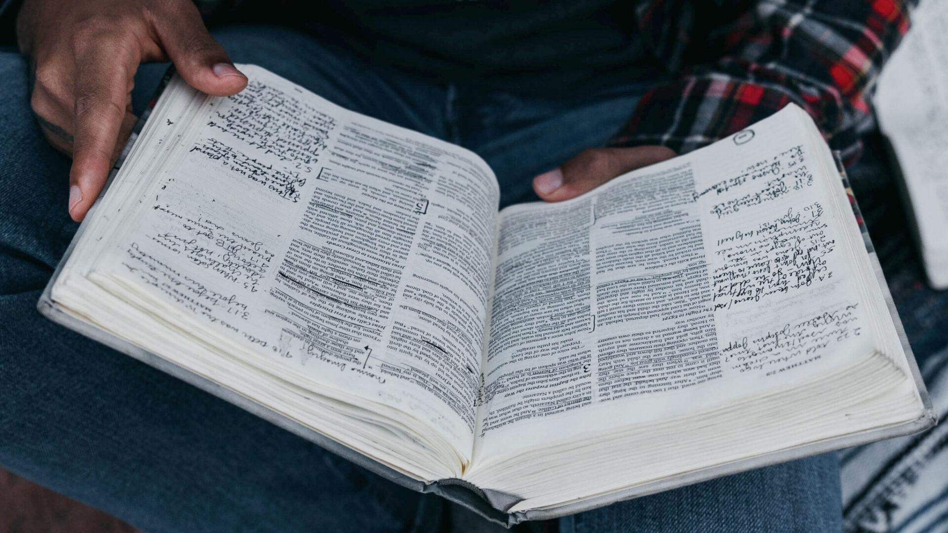 Man holding open Bible