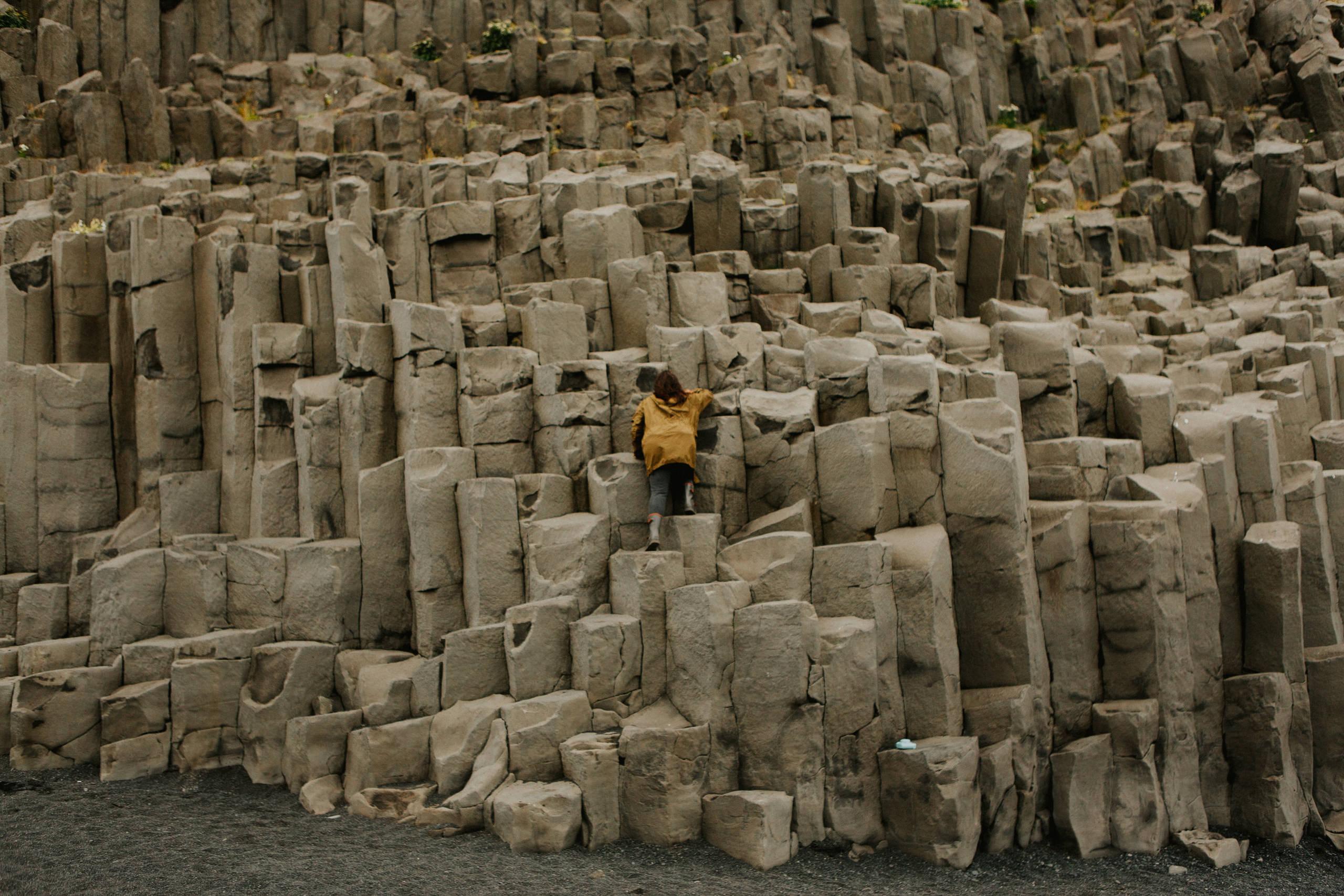 Girl climbing rock formations
