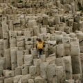 Girl climbing large rock formations