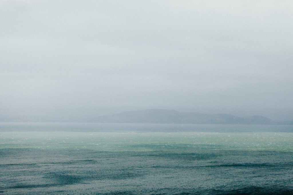 Rain falling on large body of water