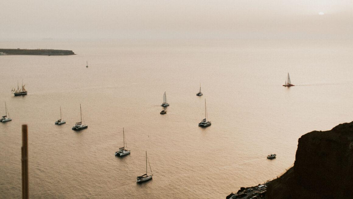Sailboats in harbor at dusk