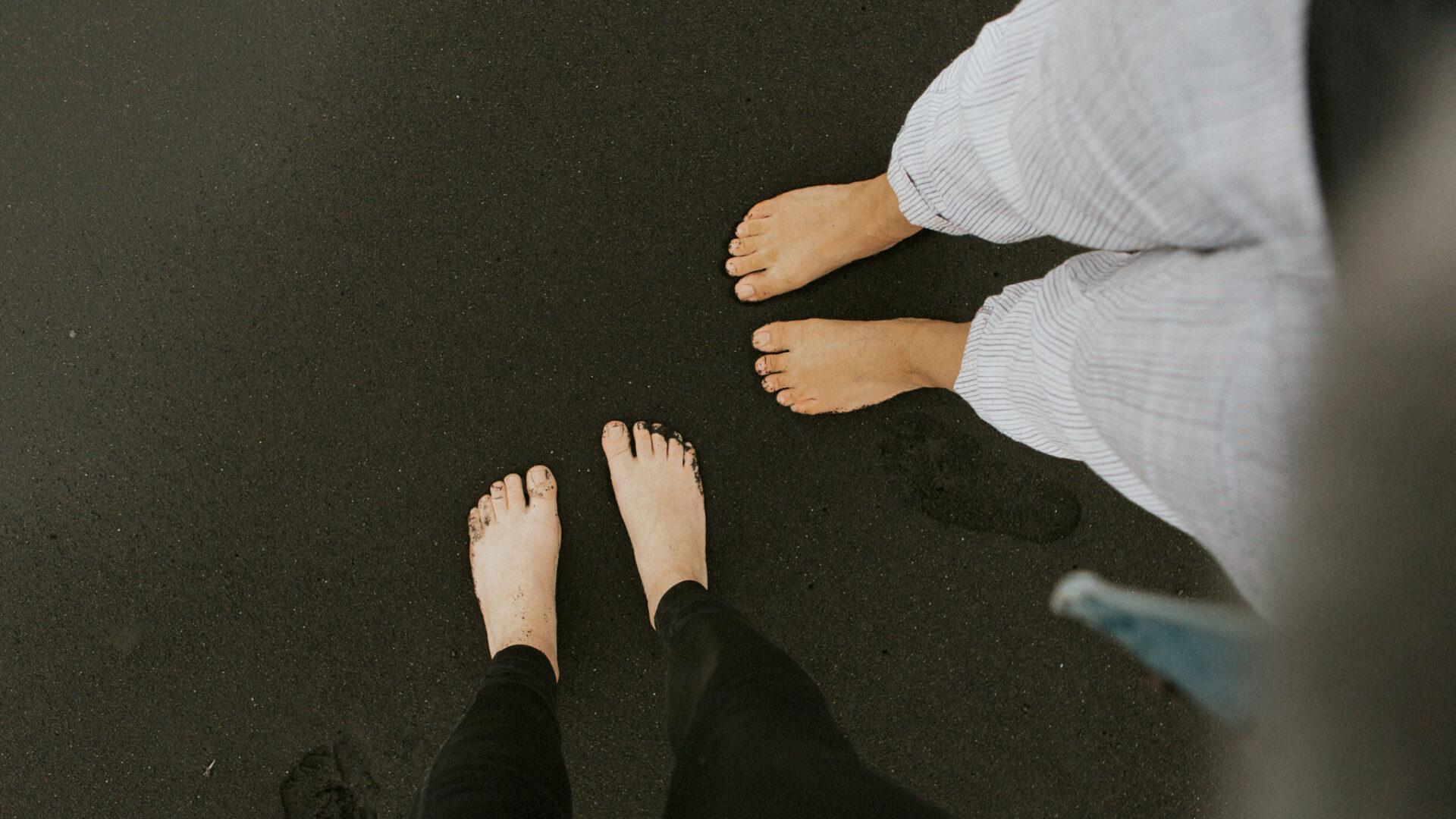 Bare feet on dark background