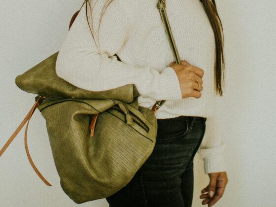 Women holding green bag