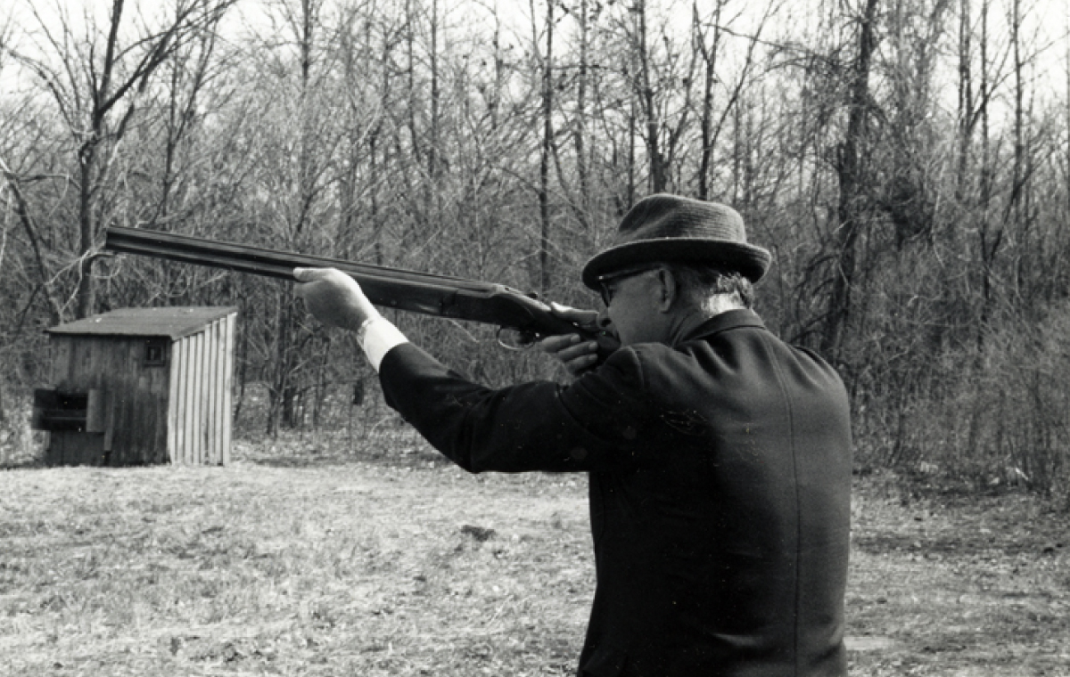 Vintage Photograph of White Gates Skeet Club Member Aiming Shotgun