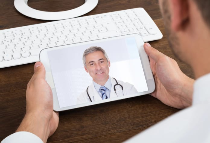 Patient using our tele-hospitalist services on a phone
