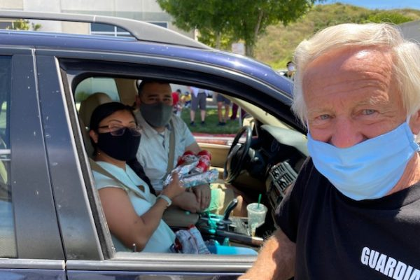 Santa Clarita Veteran Mentor Dan Paulson serves FREE Hot Dog Lunches to the Alvarado's from the H4F Veteran Enriched Neighborhood.