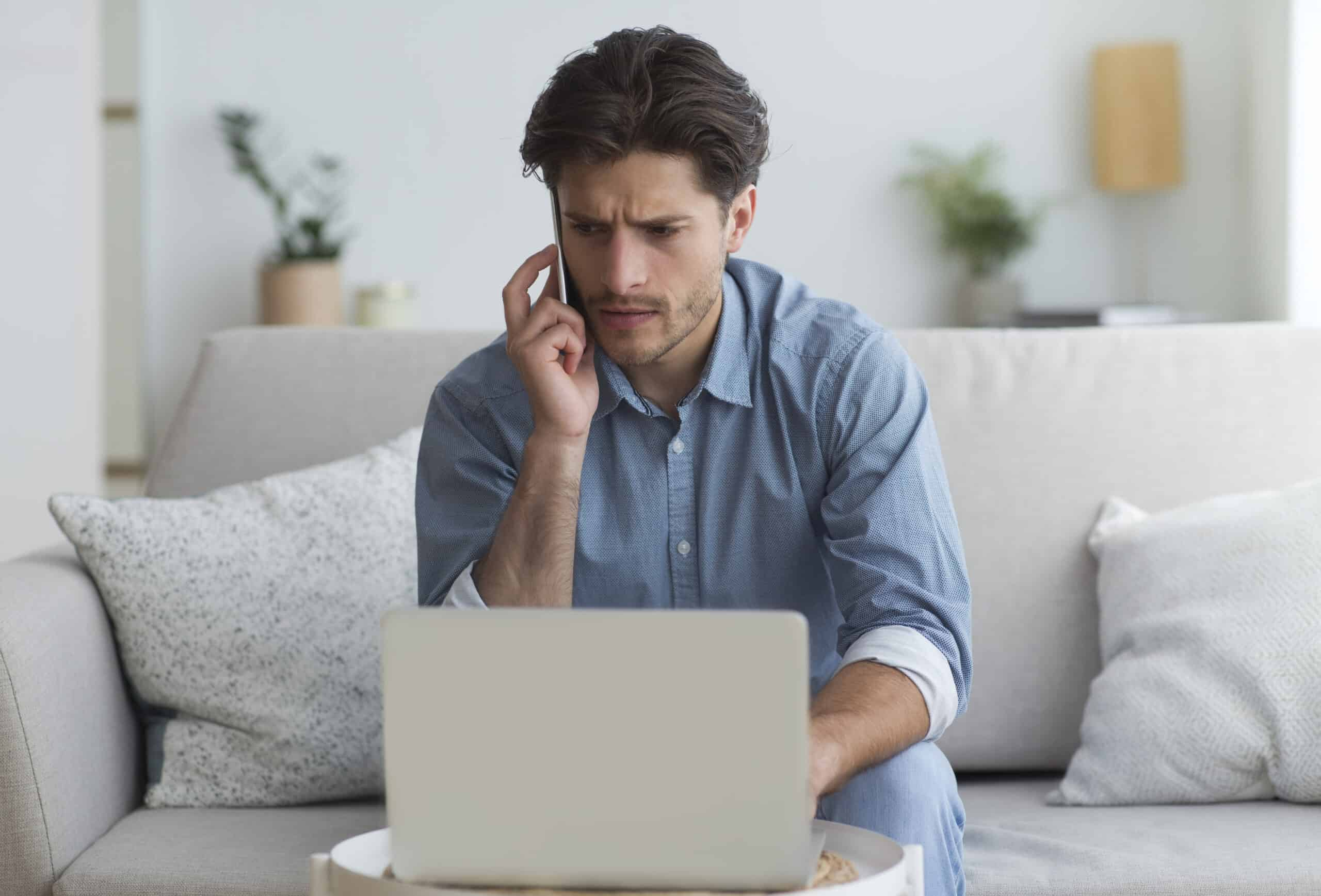 John Allan Group concerned-man-talking-on-mobile-phone-sitting-at-l-LN4XHBP-scaled Help for Homeowners