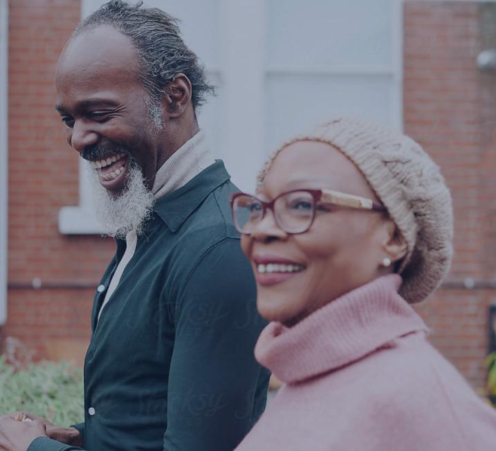 Two senior citizens smiling