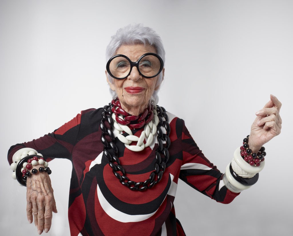 Iris wearing a psychedelic print and jewelry from the collection