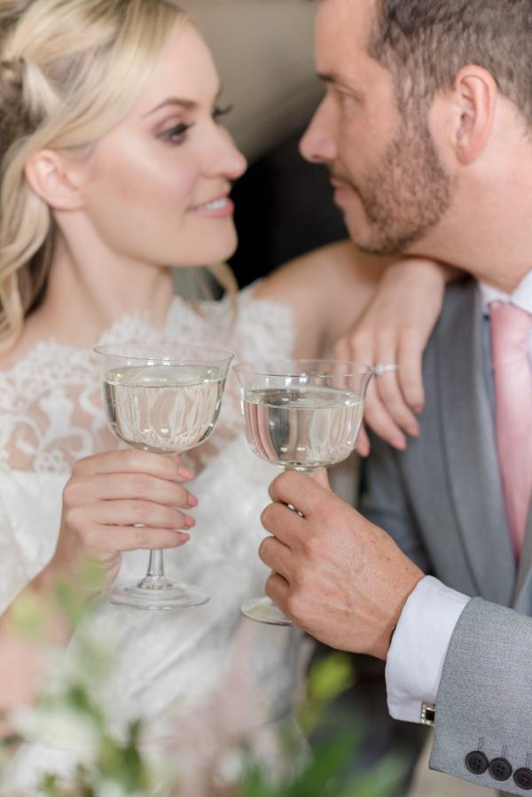 Toasting wedding couple Wotton House