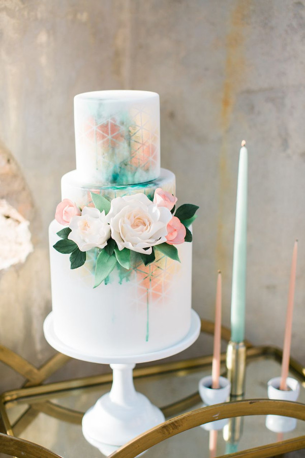 Textured 3 tier wedding cake with flower detail and tones of mint green and rose gold