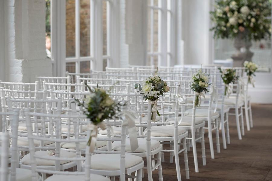 Wedding ceremony with Chiavari chairs at Holland Park Orangery